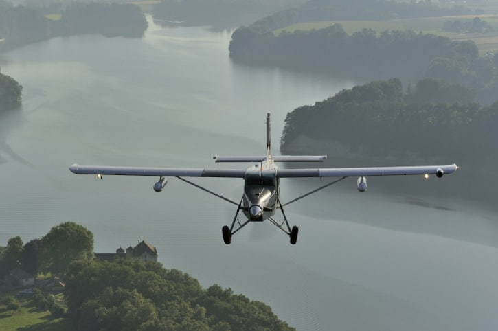 Pilatus PC-6 Turbo Porter in flight over the countryside