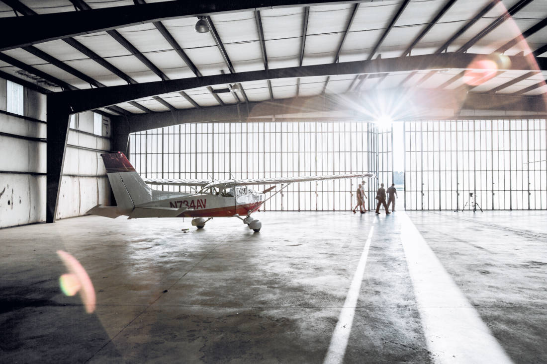 Pilots leaving a flight training school hangar - Are All Airline Pilot Training Schools the Same?