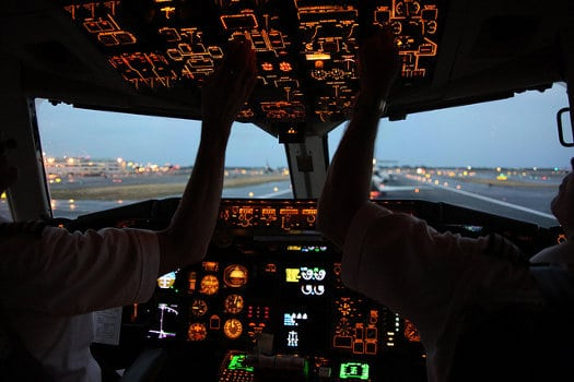 Pilots in the cockpit, prepping for evening flight - Are All Airline Pilot Training Schools the Same?