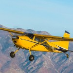 The Cessna 185 Skywagon in flight over the Salt Lake Valley