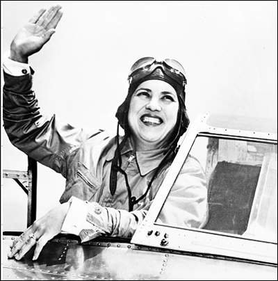 Jackie Cochran in an airplane cockpit