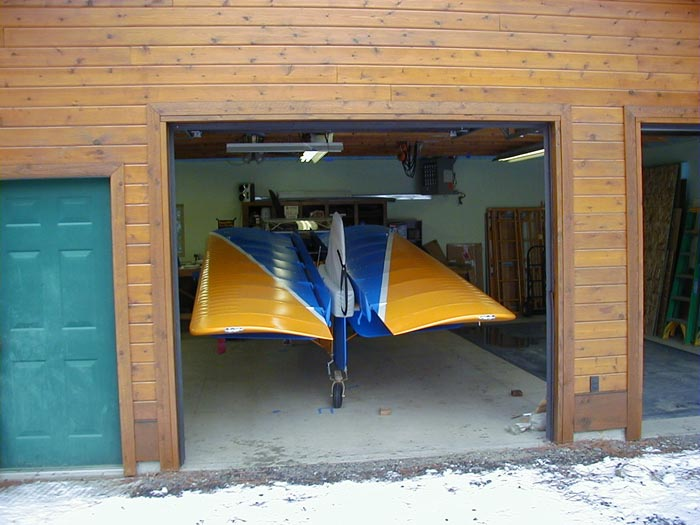 Kitfox airplane in garage with wings folded