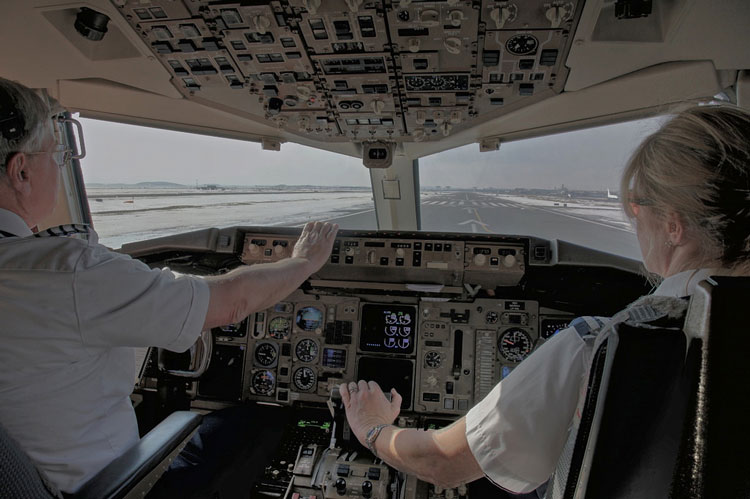 Male and Female Airline pilots in the cockpit