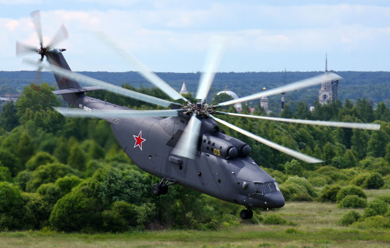 The world's largest helicopter, the Mi-26, in flight over Russian countryside