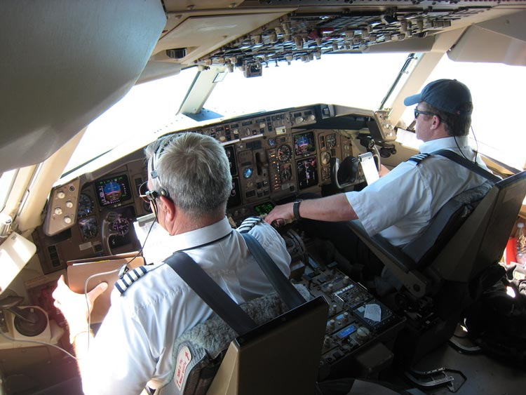Pilot and co-pilot in the cockpit of a 767