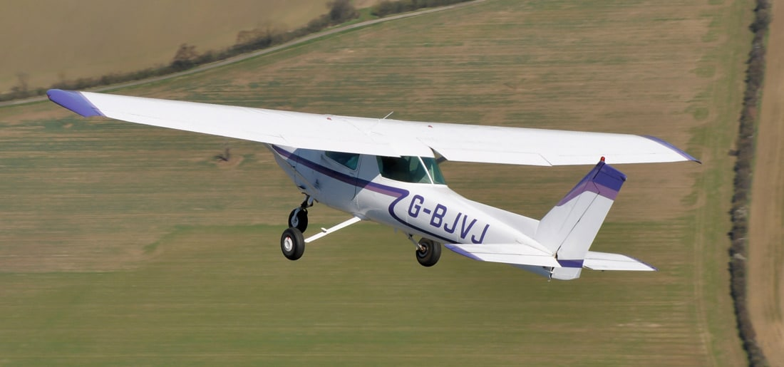 A Cessna 152 airplane in flight
