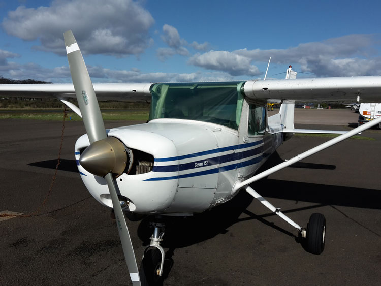 Cessna 152 airplane in transient parking