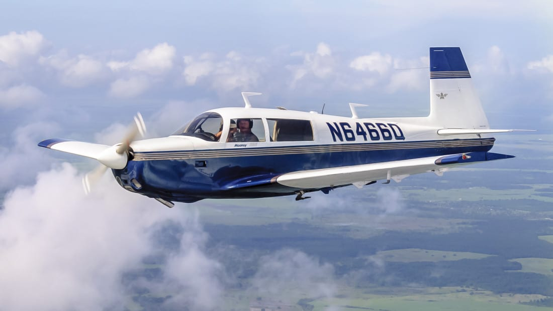 A Mooney M20 in flight