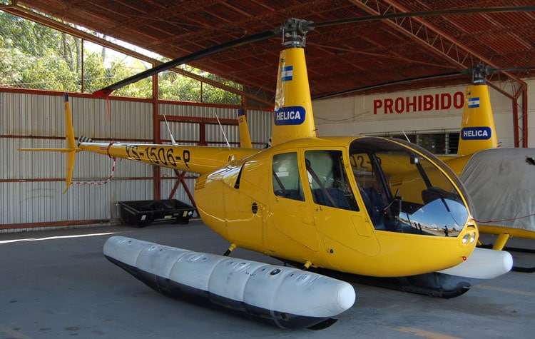A Robinson R44 Helicopter with floats