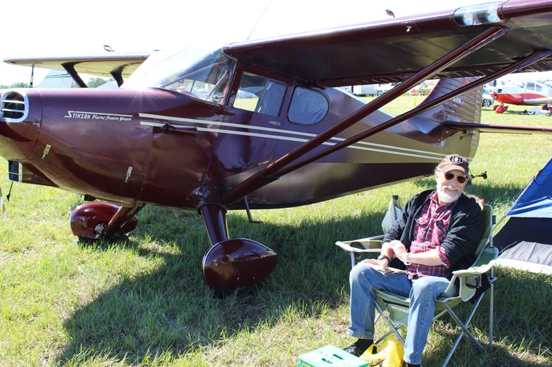 1949 Maroon Stinson aircraft with private pilot Dean Baker