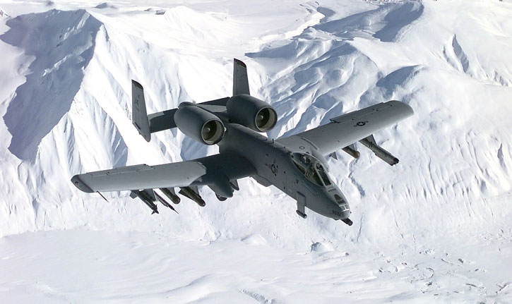 An A-10 THunderbolt II, or A-10 Warthog, flying over the snow