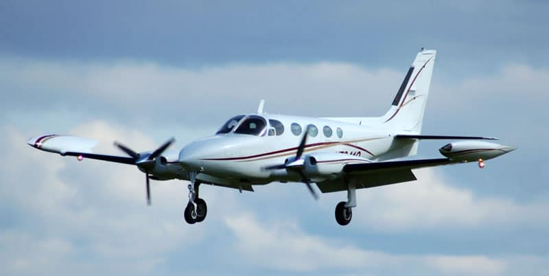 Cessna 340 flying against the clouds