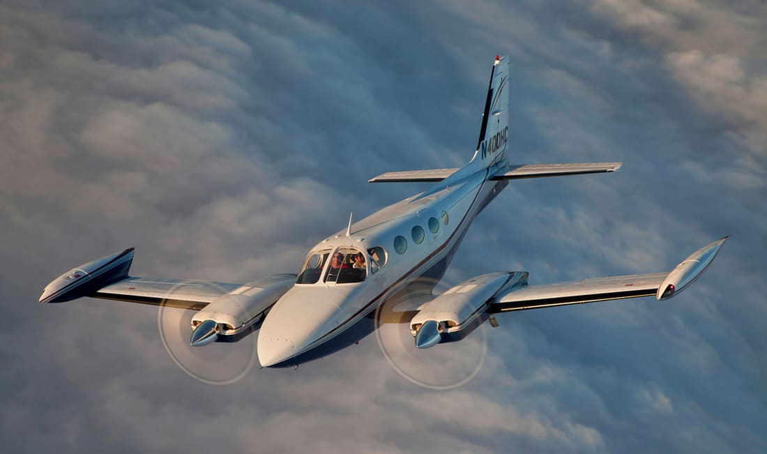 Cessna 340 In flight above the clouds