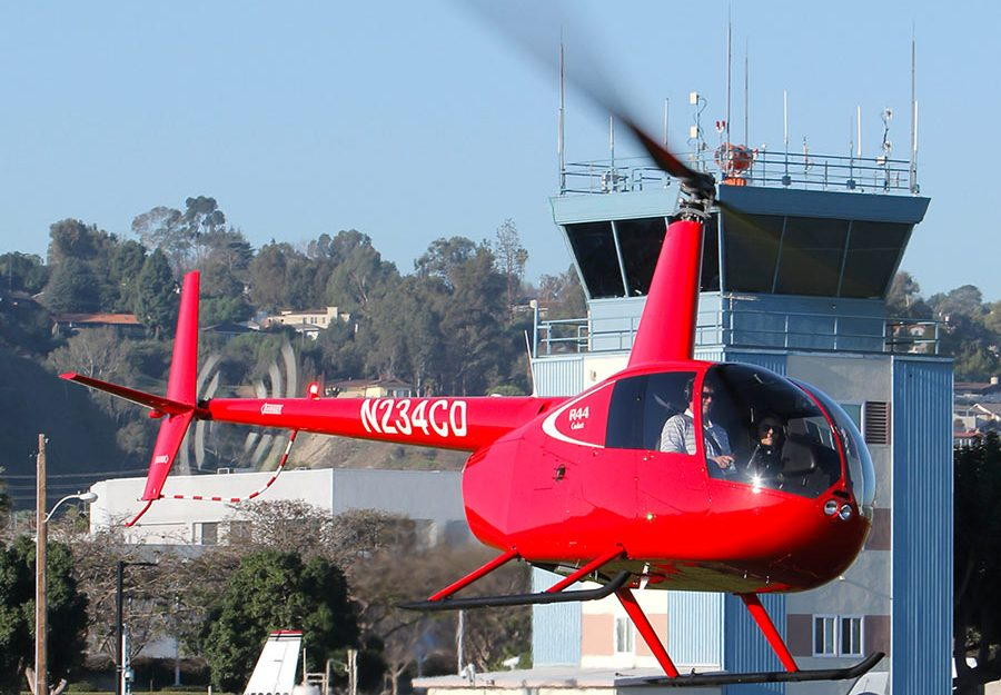 Robinson R44 Cadet helicopter in flight.