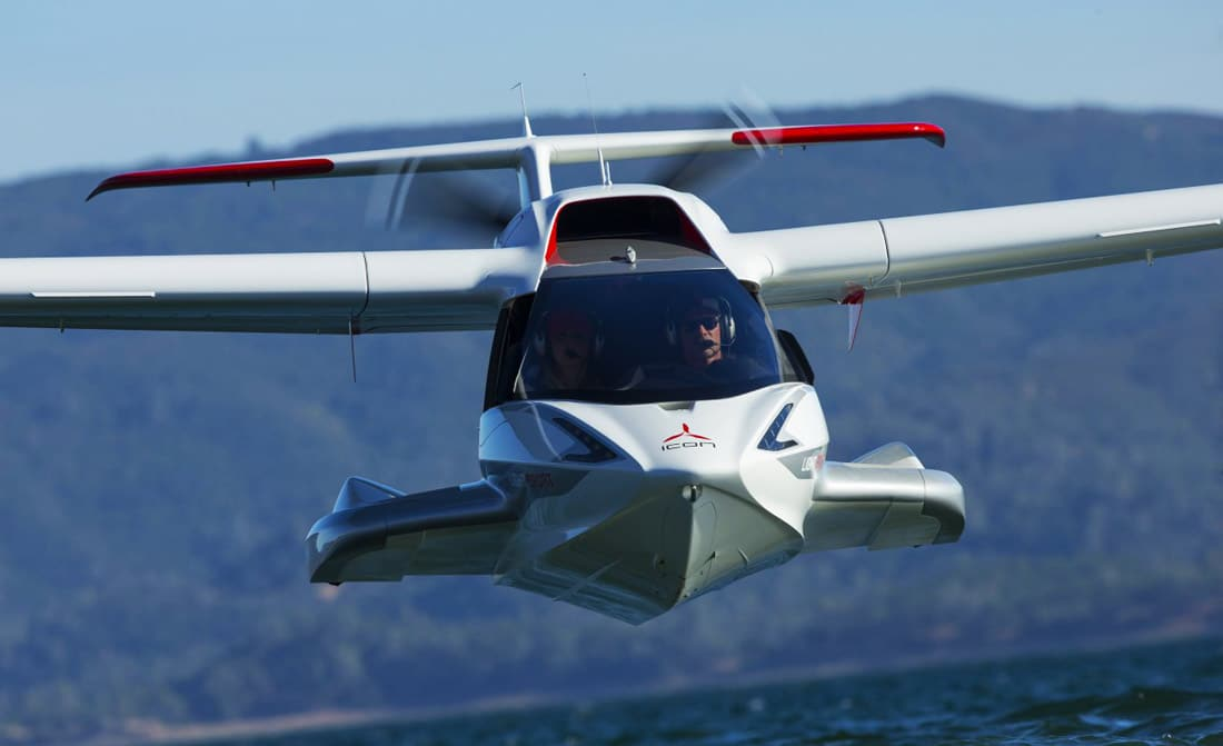 An A5 light sport aircraft from ICON Aircraft in flight over the water