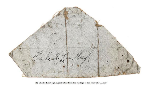 Piece of fabric from the airframe of The Spirit of St Louis, signed by Charles Lindbergh