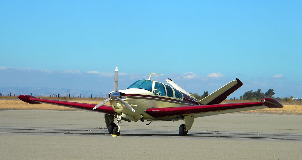 A Beechcraft Bonanza in parking at an airport - FAA's NORSEE Policy Promotes Installation of Safety Equipment