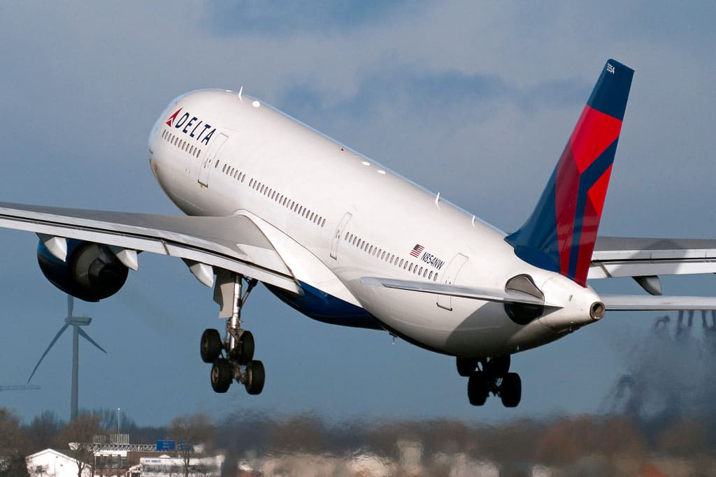Delta Airlines Jet Taking Off - Retired Delta Pilots Lawsuit Backed By Judge