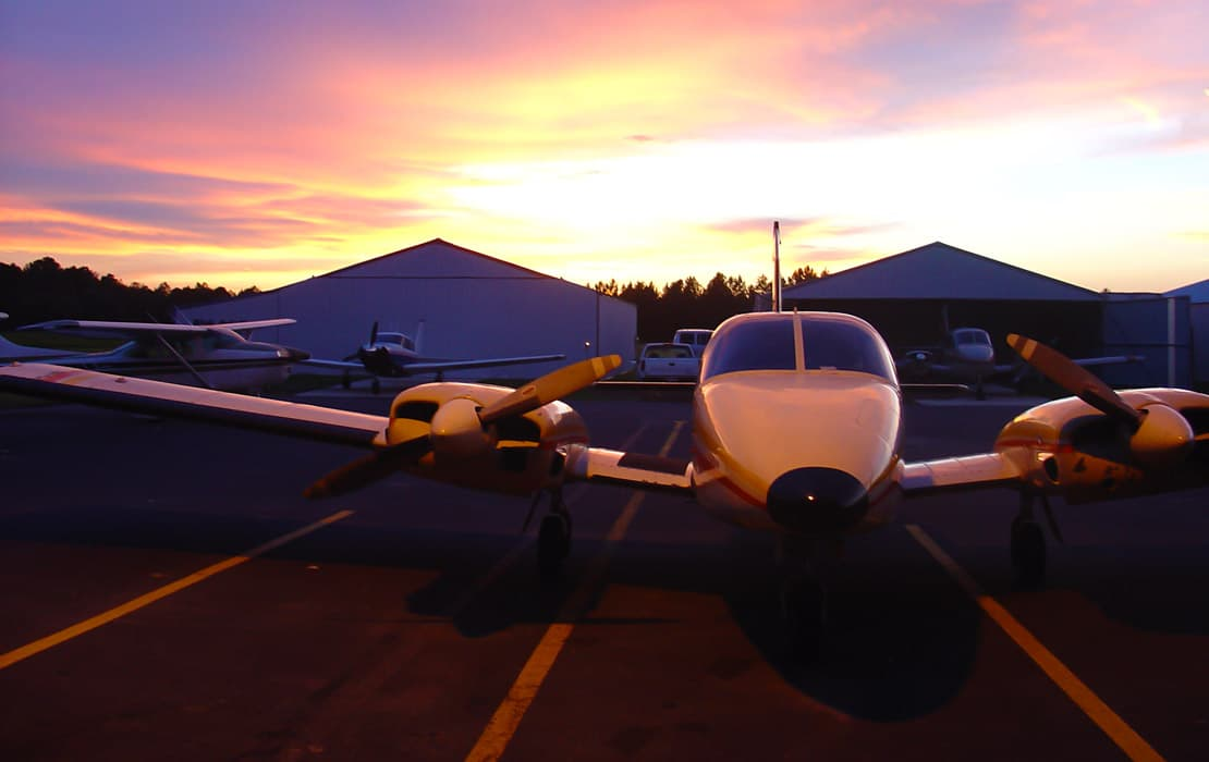 Piper Apache by hangars at sunset - FAA Proposing to Supersede Existing AD 69-13-03 for Heater Issue on Piper Twins