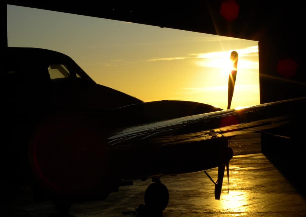 An aircraft in a hangar at sunset - New HangarBot system revealed to help secure hangars