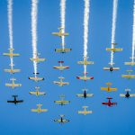 Aircraft flying in formation at EAA AirVenture 2016