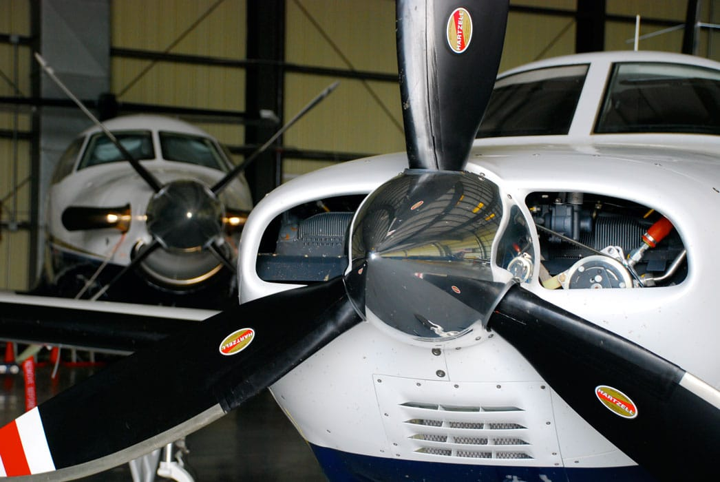 A pair of general aviation aircraft in a hangar - FAA and International Partners form Certification Management Team to streamline certification process