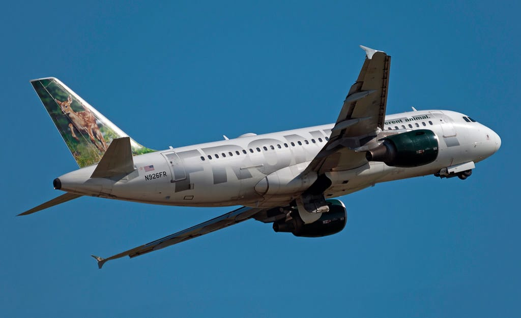 Frontier Airlines aircraft in flight - Frontier Pilots Request Federal Mediator in Contract Dispute