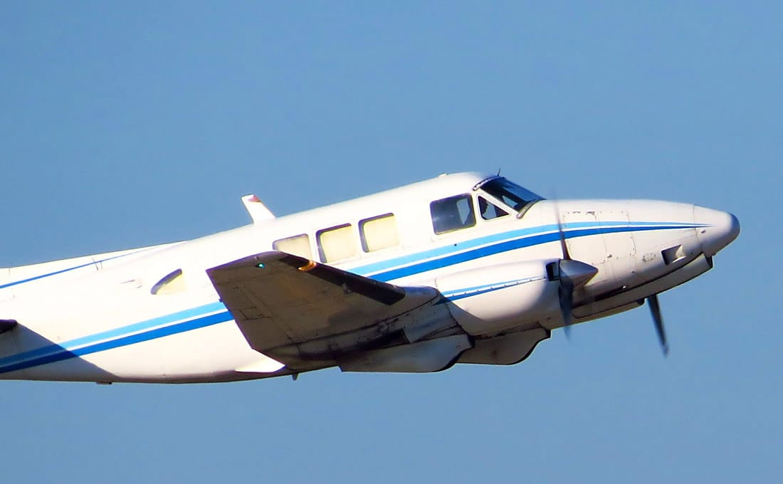 A Beechcraft Queen Air in flight - FAA Issues Emergency Order Grounding Western Air Express Operations