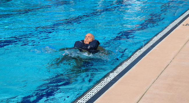 A general aviation pilot taking part in a swim test as part of training
