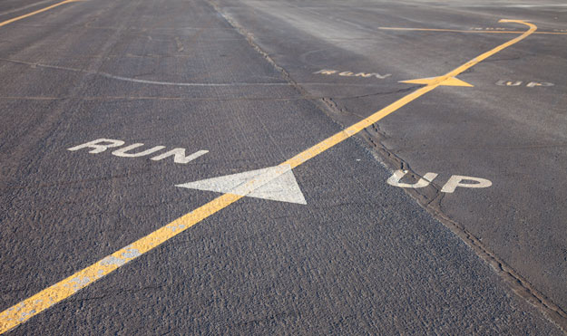 The arrows on a runway designating the run up area