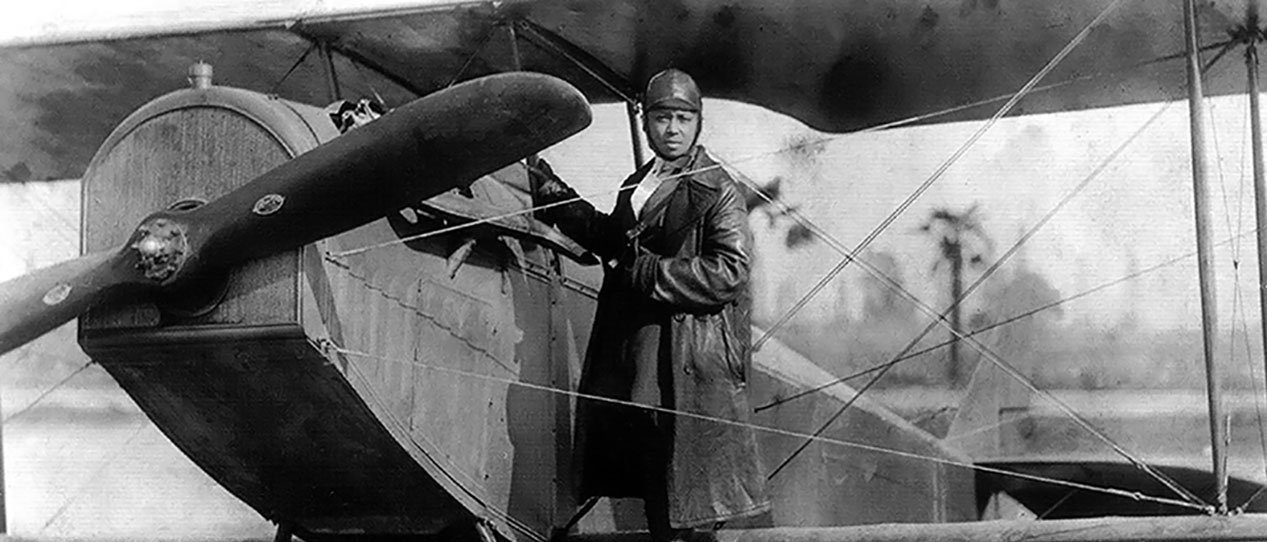 Bessie Coleman with her airplane
