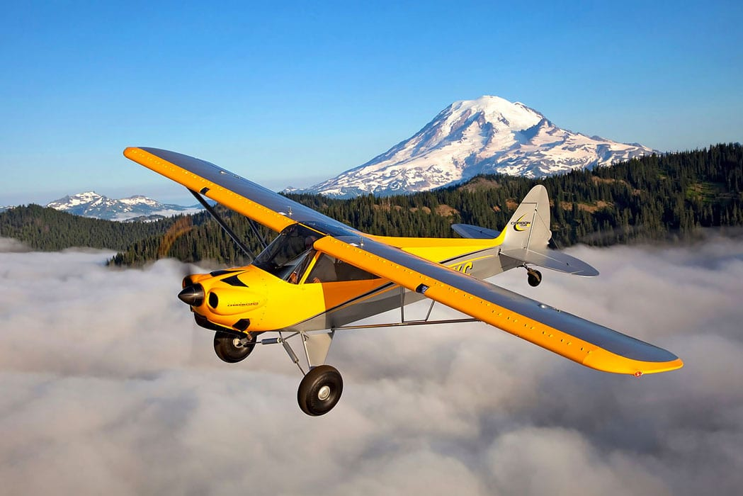 CubCrafters Carbon Cub SS in flight - CubCrafters announces new retrofit airframe parachute systems for select aircraft models