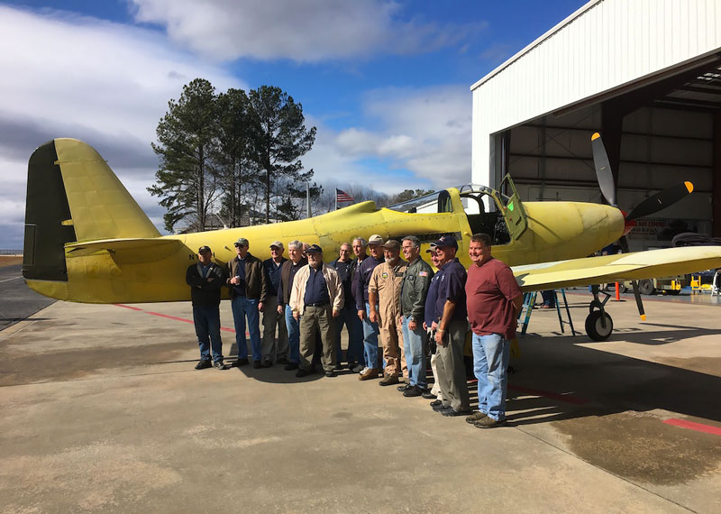 Restored P-63 Kingcobra with restoration crew