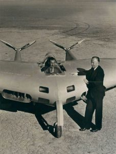 jack northrop posing with flying wing prototype