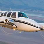 Beechcraft Baron 58 in flight - The 58TC model