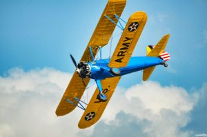 boeing-stearman model 75 in flight against a blue sky