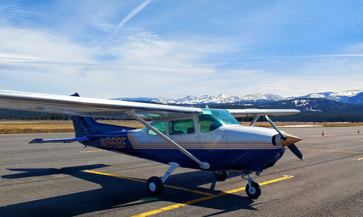 A Cessna Skyhawk 172 on the runway at Tahoe Truckee Airport, just before a flying in turbulence to Reno-Stead Airport
