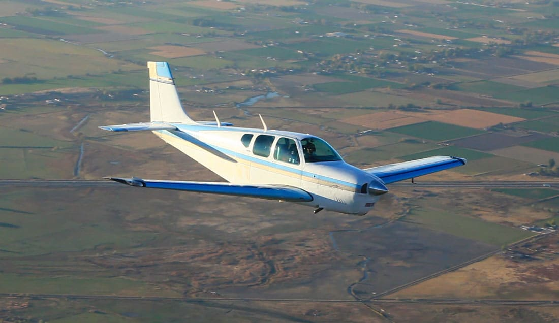 Beechcraft Debonair in flight, with an IO-470 engine, which might be affected by a recent Continental engine service bulletin being upgraded to mandatory