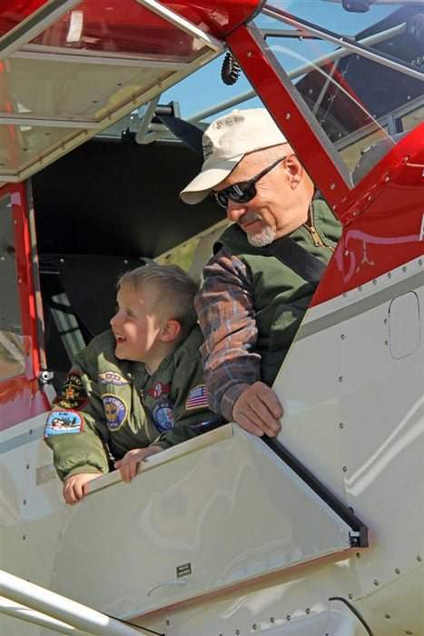 Bob Hoff and grandson in a Husky