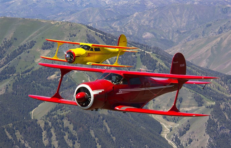Two Beechcraft Model 17 Staggerwing aircraft in flight