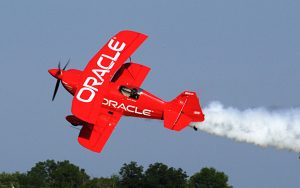 famous airshow pilot sean tucker flying his red biplane for team oracle