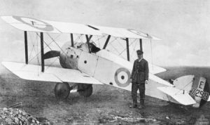 Captain GF Malley of the Australian Flying Corps standing next to his Sopwith Camel in 1918. Image is in the public domain.
