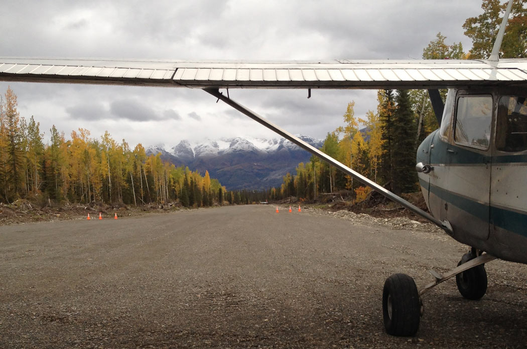 Airplane at Jake's Bar airstrip in the Alaska backcountry