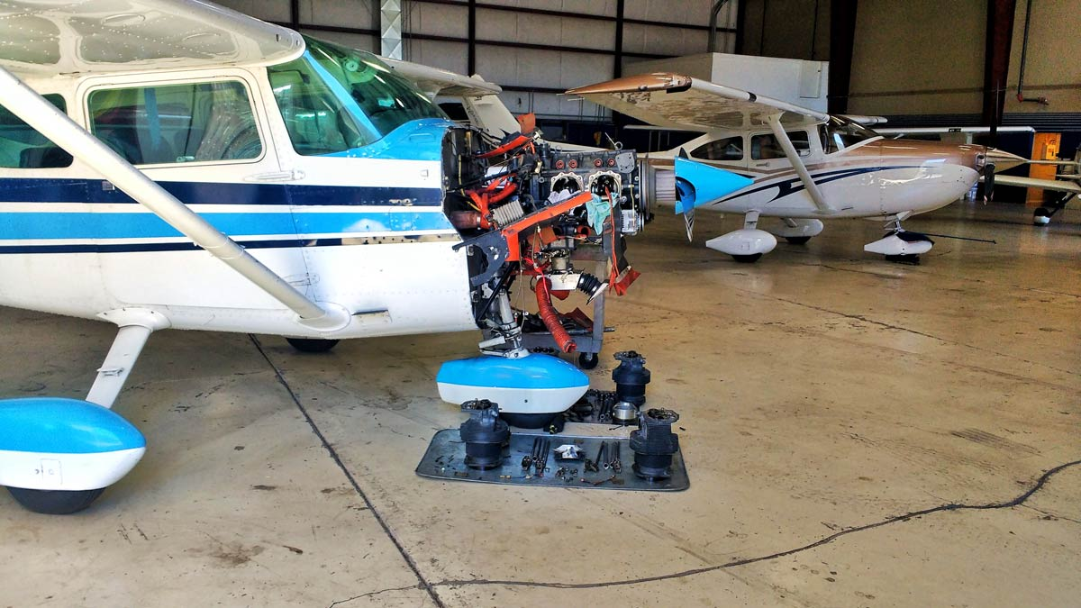 A Cessna 182 being worked on by a mechanic - Using the Airplane Squawk Sheet and Squawk Etiquette