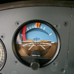 Attitude Indicator on an instrument panel, the subject of