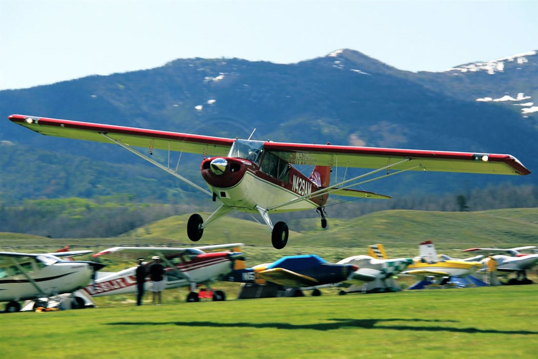 Savannah Hoff (Bob's granddaughter) taking off from the Smiley Creek in an Aviat Husky, Idaho airstrip.